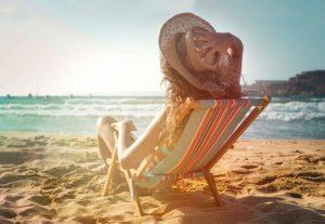 Woman sitting in beach chair at the beach