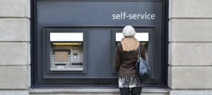 Girl standing at ATM