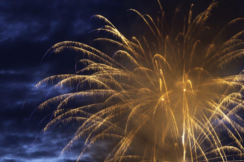 A single giant golden firework exploding